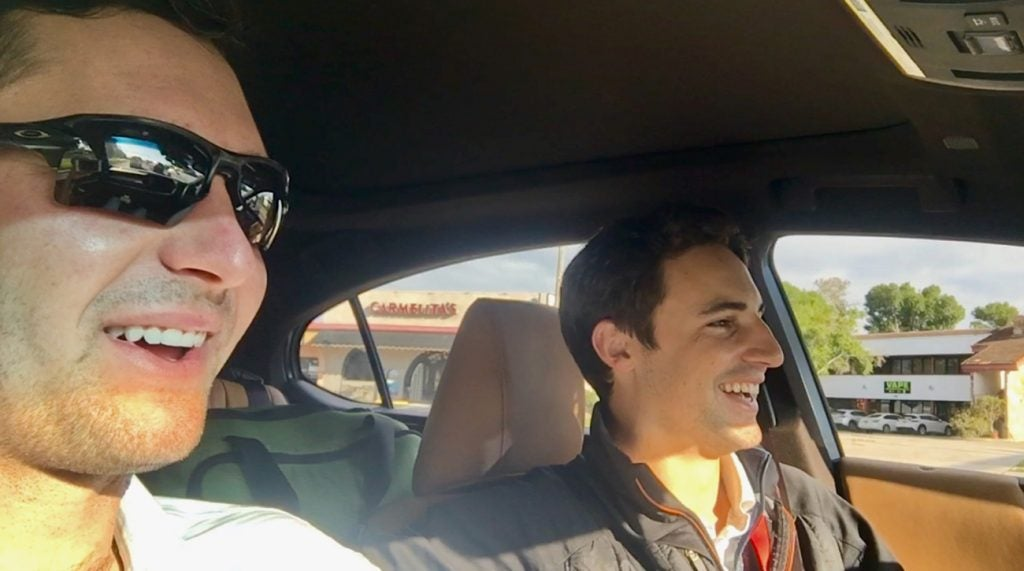 Just a golfer and his (brand new) caddie sharing a laugh in the car.