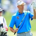 """Jim Furyk and """"Fluff"""" look over a shot on Sunday at the Players Championship."""