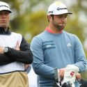 Jon Rahm and caddie Adam Hayes stand on the 12th tee after their bogey on 11 on Sunday at the Players Championship.