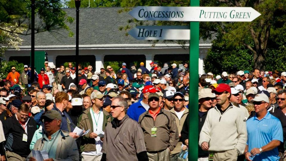 Masters patrons flood through the gates at Augusta National Golf Club.