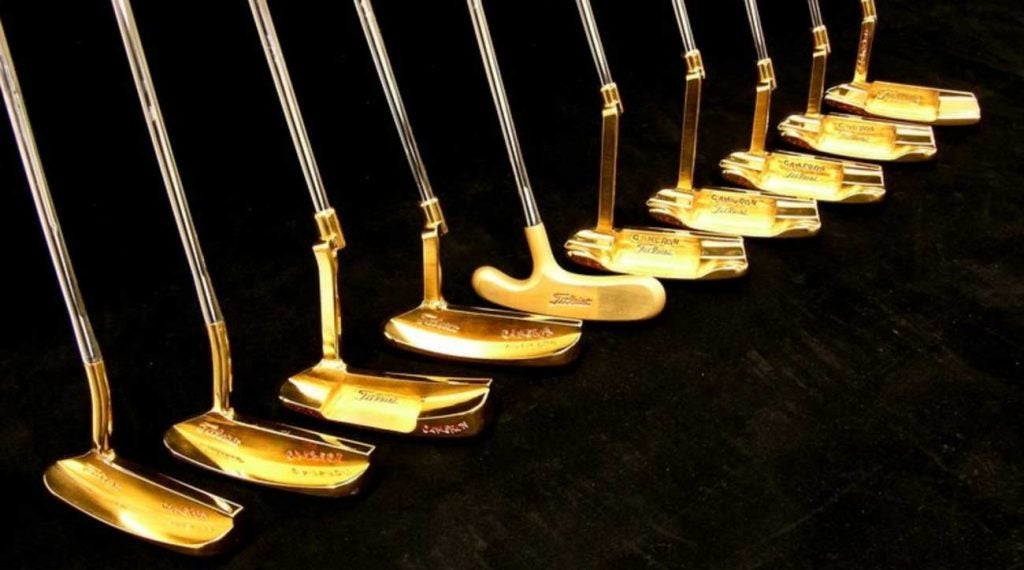 A trio of Tiger Woods winning putters are located within.