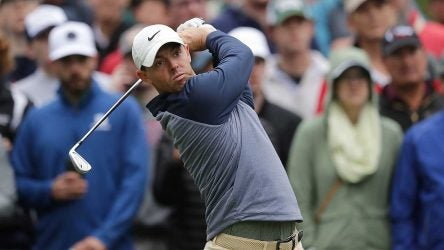 Rory McIlroy hits an approach in the Players final round.