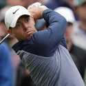 Rory McIlroy hits iron at the Players.