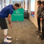 Steph Curry takes his shot during a putting contest with Augusta National Women's Amateur players