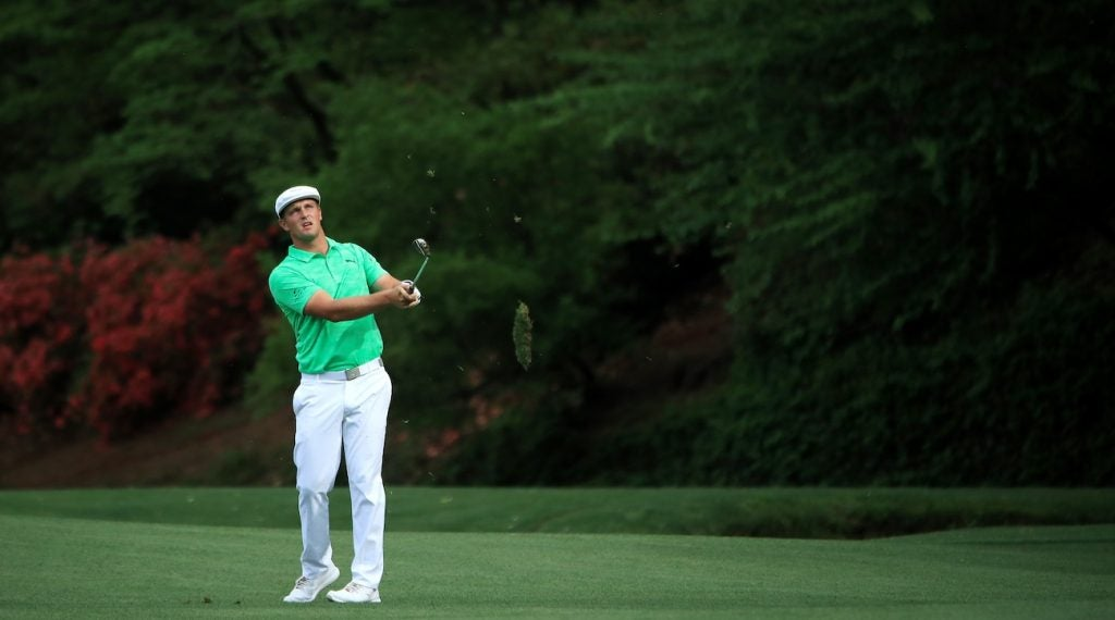 Bryson DeChambeau eyes an iron shot during the first round of the Masters.