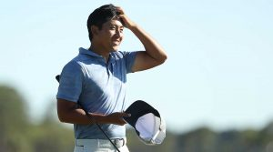 C.T. Pan walks off the 18th green on Sunday at the RBC Heritage.