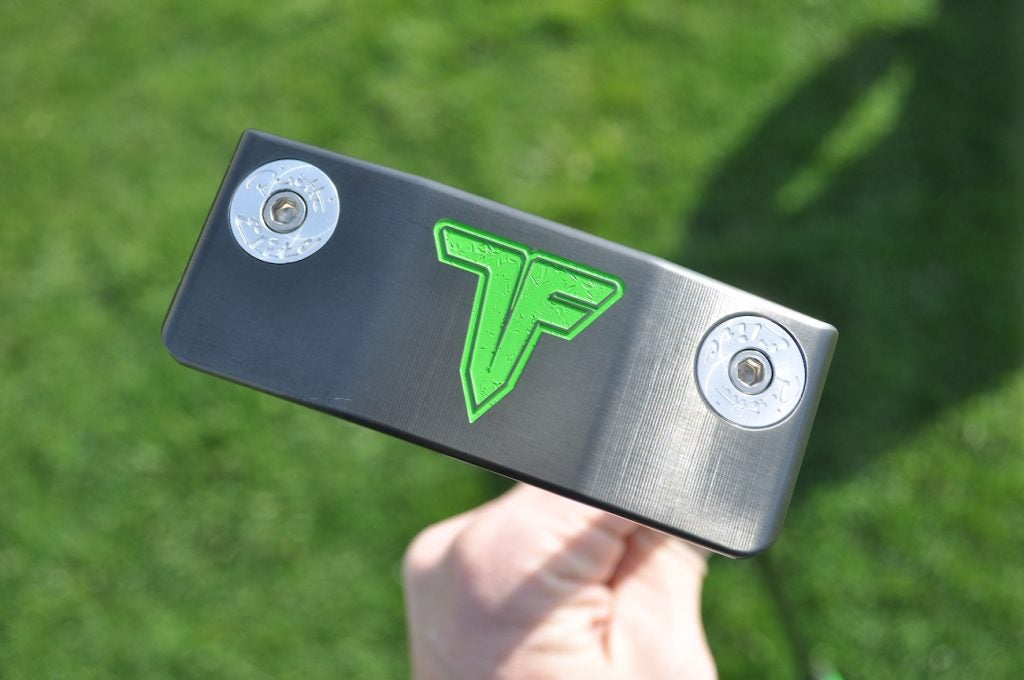 A custom Piretti putter made for Tony Finau with his personal logo etched into the sole and heel-toe weights.