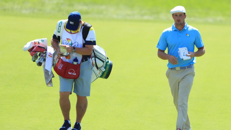 ORLANDO, FLORIDA - MARCH 07: Bryson DeChambeau of the United States walks with his caddie up the second hole during the first round of the Arnold Palmer Invitational Presented by Mastercard at the Bay Hill Club on March 07, 2019 in Orlando, Florida. (Photo by Sam Greenwood/Getty Images)