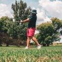 Man swinging golf club with proper golf grip