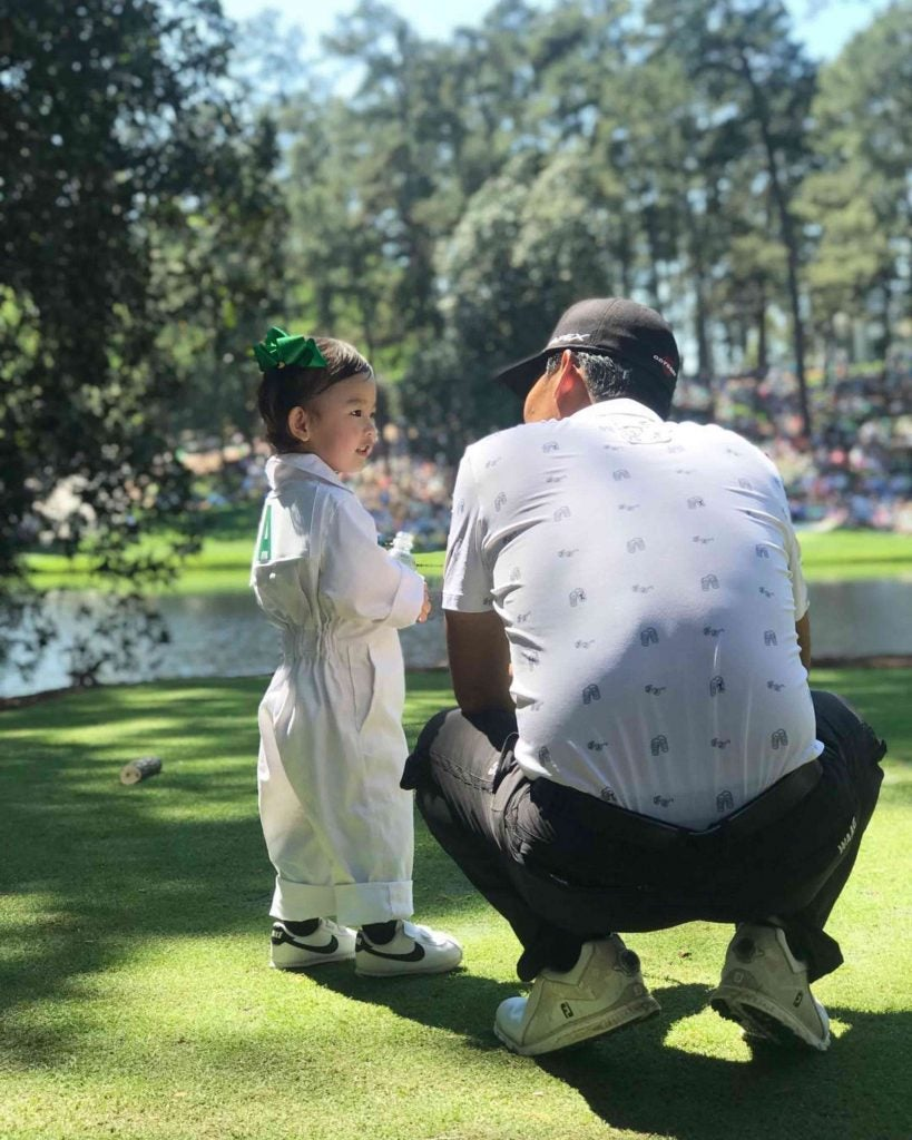 Kevin Na shares a special moment with his daughter.