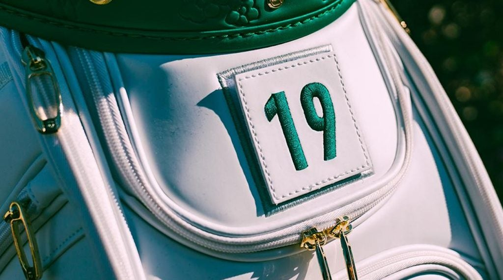 Each caddie is assigned a numbered jumpsuit based on when their player checks in. The defending champion's caddie gets the number one. The number on the staff bag will match the jumpsuit number.