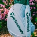 The white and green design pays homage to the caddie jumpsuits at the Masters.