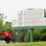 Tiger Woods surveys his putt on the 18th hole during the final round of the 2019 Masters.