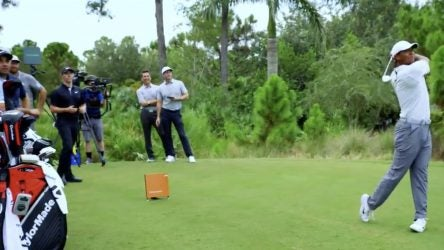 Tiger Woods takes a cut with TaylorMade's Pittsburgh Persimmon driver.