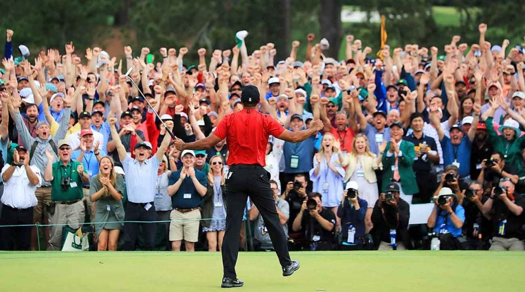 Woods, and about 25,000 fans, went crazy after his final putt dropped.