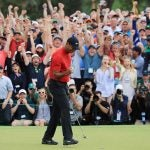 Tiger Woods pumps his fist after winning the 2019 Masters.