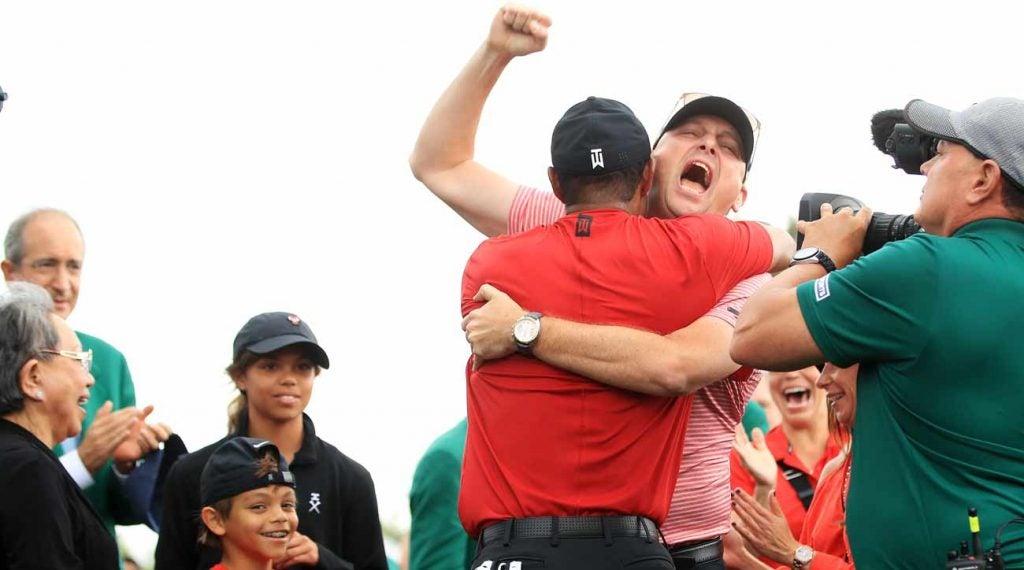 Tiger Woods and Rob McNamara shared a moment behind the 18th green.