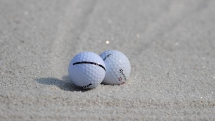 Two golf balls in bunker