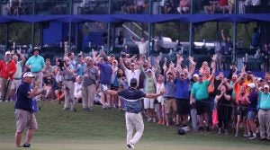 The crowd reacts to Kevin Kisner's walk-up music at the Zurich Classic.