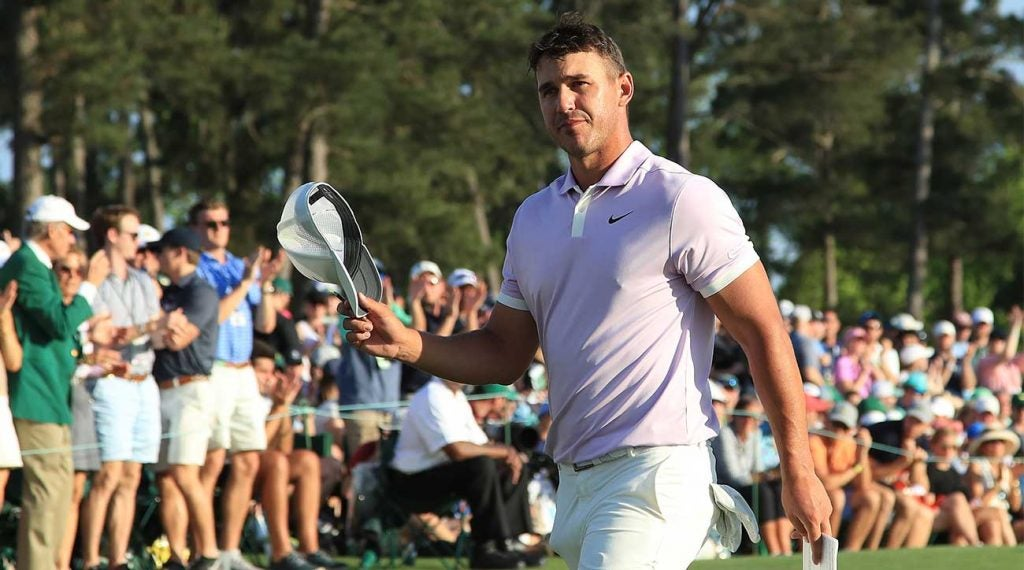 Brooks Koepka walks off the green after his Masters round on Saturday. Koepka is three off the lead with 18 holes to play.
