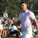 Brooks Koepka walks off the green after his Masters round on Saturday.