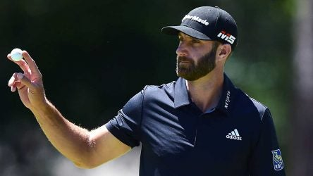 Dustin Johnson waves to the crowd during the RBC Heritage.