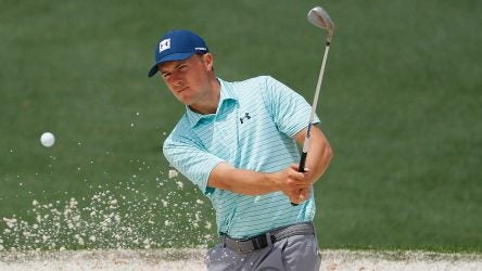 Jordan Spieth blasts out of a bunker during a practice round at the Masters.