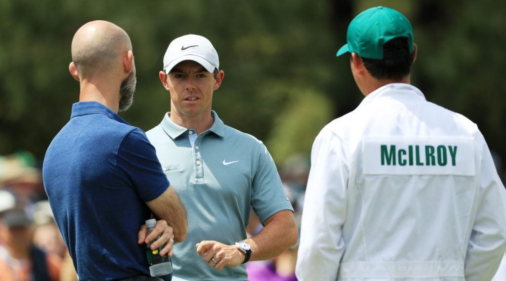 Rory McIlroy (center) talks with Dr. Clayton Skaggs and his caddie Harry Diamond on the putting green Tuesday afternoon.