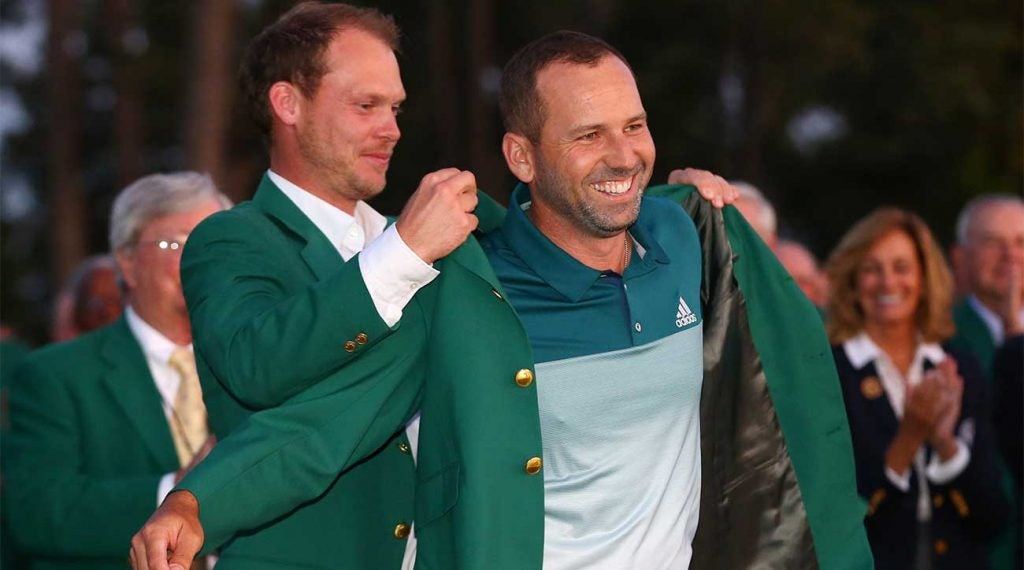 Danny Willett puts the green jacket on Sergio Garcia after Garcia won the Masters in 2017. This year's winner will receive a record payout.