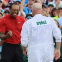 Tiger Woods and caddie Joe LaCava celebrate Woods's Masters victory.