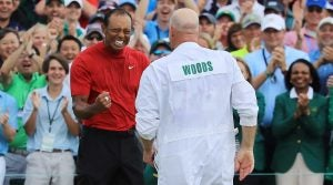 Tiger Woods and caddie Joe LaCava celebrate Woods's Masters victory.