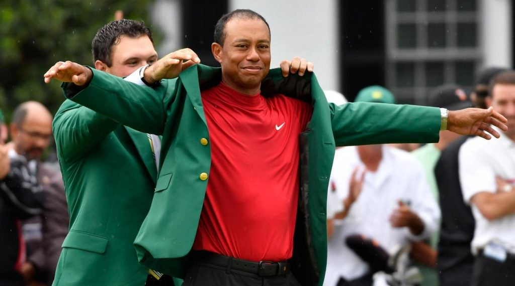 Patrick Reed helps Tiger Woods into his green jacket Sunday at the 2019 Masters.