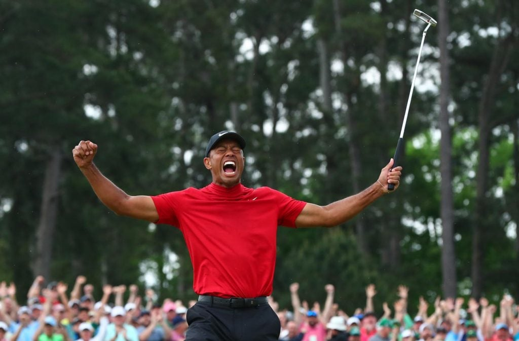 Tiger throws his arms into the air moments after sinking the winning putt at the 2019 Masters.