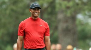 Tiger Woods walks down the fairway on Sunday at the Masters.