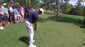 Tiger Woods prepares to hit his appraoch shot from the trees on Augusta's 14th hole at the Masters.