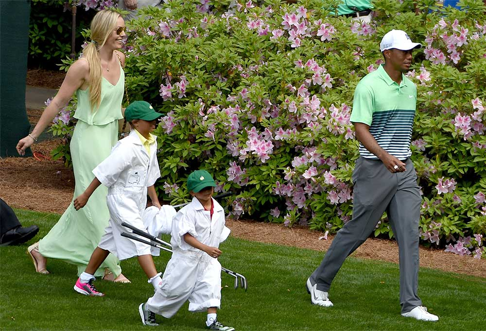 Tiger Woods and Lindsey Vonn with Woods's kids, daughter Sam (7 at the time), and son Charlie (6), as caddies at the 2015 Masters Par-3 Contest.