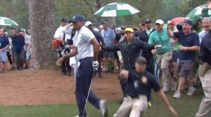 Tiger Woods Masters: Security guard nearly slides into Tiger Woods after an incredible recovery shot Friday at the Masters