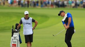 Brooks Koepka pitches out from the rough during the final round of the PGA Championship.
