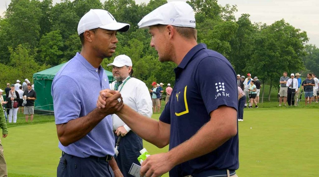 Bryson DeChambeau and Tiger Woods greeted each other before Thursday's first round at the Memorial.