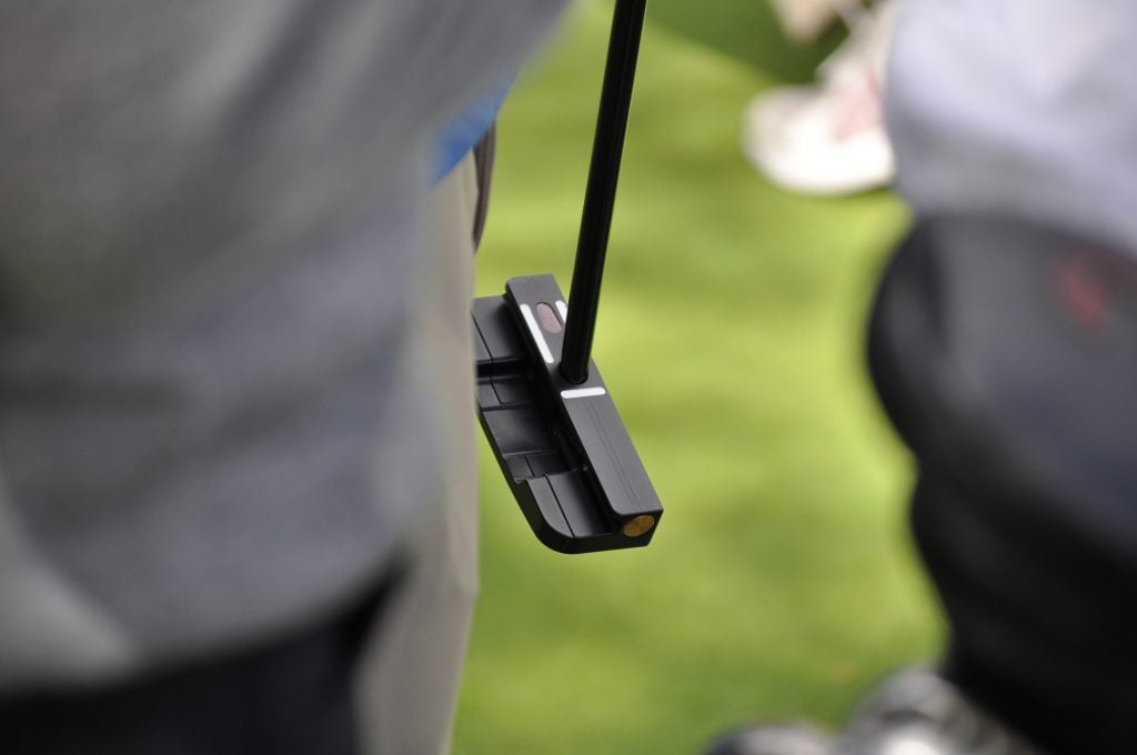 Zach Johnson tested a Seemore putter featuring a visible weight plug for toe hang purposes.