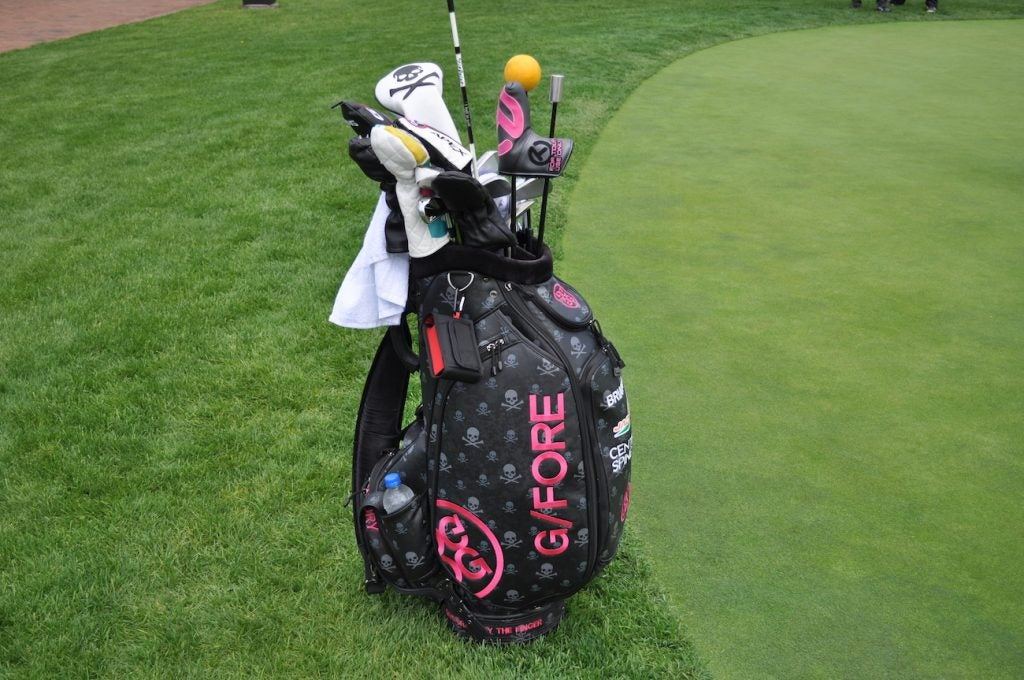 Brian Gay's pink and black GFore staff bag is impossible to miss on the putting green.