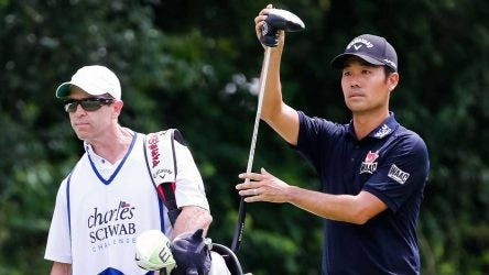 Kevin Na and caddie Kenny Harms get ready to play a shot on Sunday at Colonial.
