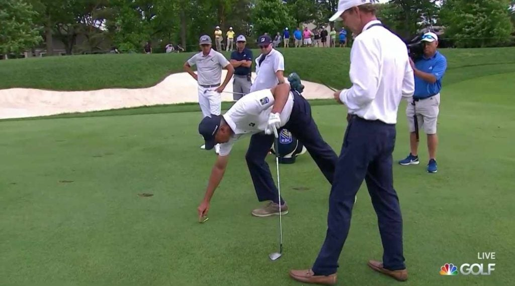 Matt Kuchar and Robby Ware, with Rickie Fowler looking on.