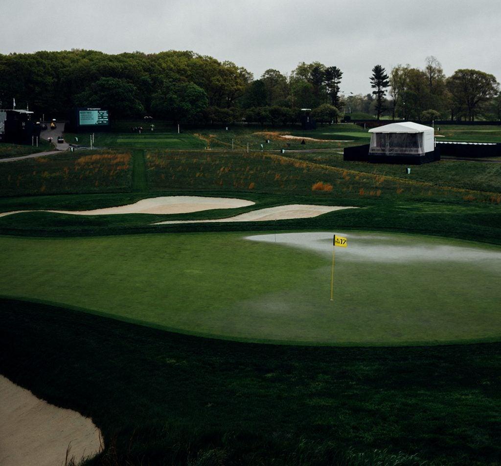 A rain-soaked 17th green.