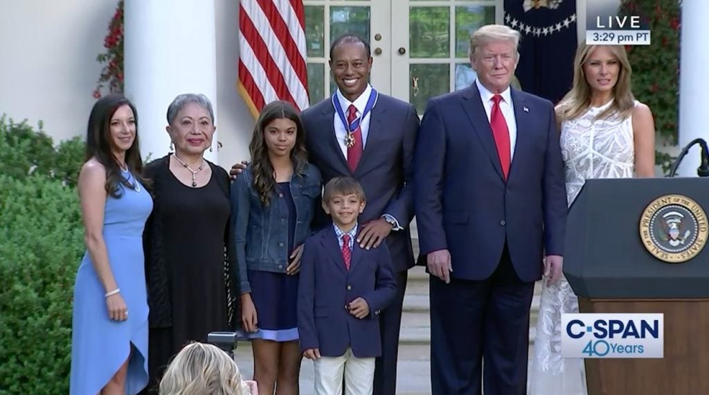 Tiger Woods poses with his girlfriend, mother and children alongside President Trump and Melania Trump.