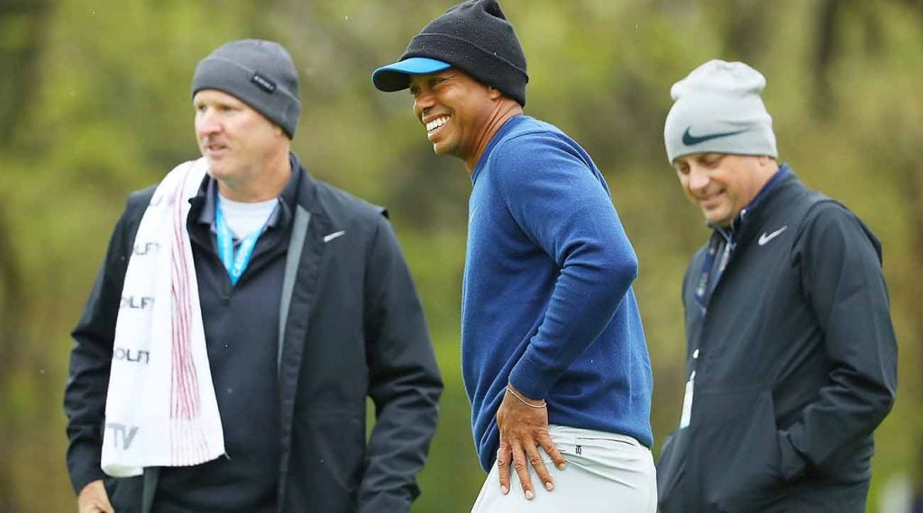 Woods played a cold, blustery practice round Monday at Bethpage.