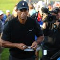 Tiger Woods walks off a green during the third round of the PGA Championship.