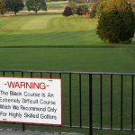 Bethpage Black's Warning sign dares golfers to play the Black Course.