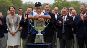 Brooks Koepka poses with the trophy after winning the PGA Championship on Sunday night.