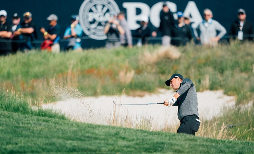 Spieth blasts one out of a bunker.